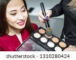 makeup artist applying powder...   Shutterstock . vector #1310280424