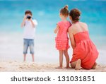 Boy Photographing His Mother...