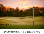 view over golf course at sunset. | Shutterstock . vector #1310339797