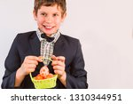 boy smiles and holds a basket... | Shutterstock . vector #1310344951