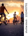 defocus silhouettes of cyclists ... | Shutterstock . vector #1310405701
