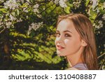 blonde woman in garden with... | Shutterstock . vector #1310408887