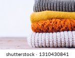 pile of knitted woolen sweaters ... | Shutterstock . vector #1310430841
