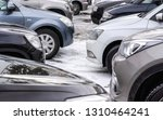 cars parked in snow covered...   Shutterstock . vector #1310464241