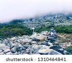 a pile of stones become a cairn ... | Shutterstock . vector #1310464841