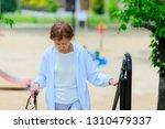 elderly women climbing stairs   Shutterstock . vector #1310479337