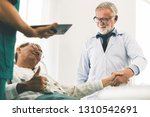 mature doctor talking and...   Shutterstock . vector #1310542691