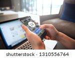 online payment. hands of woman... | Shutterstock . vector #1310556764