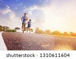 fit men running sprinting along ... | Shutterstock . vector #1310611604