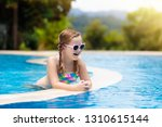 child playing in swimming pool. ...   Shutterstock . vector #1310615144