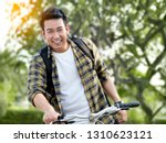 happy asian man with backpack... | Shutterstock . vector #1310623121