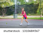 child playing tennis on indoor...   Shutterstock . vector #1310684567