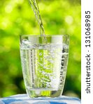 glass of water on nature... | Shutterstock . vector #131068985