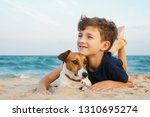happy boy hugging his dog breed ...   Shutterstock . vector #1310695274