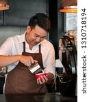 happy asian barista pouring... | Shutterstock . vector #1310718194
