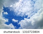white cumulus and scattered... | Shutterstock . vector #1310723804