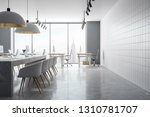 coworking office interior with... | Shutterstock . vector #1310781707