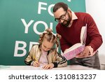 dictation. dark haired bearded... | Shutterstock . vector #1310813237