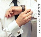 man buttoning cuffs   Shutterstock . vector #131082227
