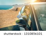 happiness young woman traveler... | Shutterstock . vector #1310856101