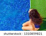 millennial woman relaxing by... | Shutterstock . vector #1310859821
