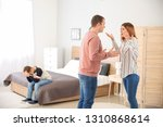 sad little boy with his... | Shutterstock . vector #1310868614