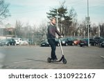 Millennial Guy Riding Electric...