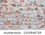 obsolete bricks wall background.... | Shutterstock . vector #1310946734