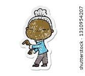 distressed sticker of a cartoon ... | Shutterstock .eps vector #1310954207