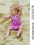 Little baby girl portrait beach - stock photo