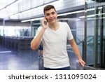 portrait of young confident man ... | Shutterstock . vector #1311095024