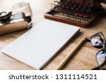 blank note book with typewriter ... | Shutterstock . vector #1311114521