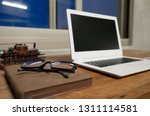 working at home with laptop on... | Shutterstock . vector #1311114581