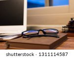 working at home with laptop on... | Shutterstock . vector #1311114587