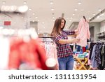 young beautiful brunette... | Shutterstock . vector #1311131954