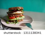avocado on toast with eggs and... | Shutterstock . vector #1311138341