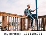 young man sitting in san...   Shutterstock . vector #1311156731