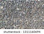 gabion rock wall  stones in... | Shutterstock . vector #1311160694
