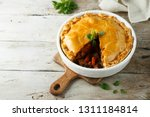 homemade meat pie | Shutterstock . vector #1311184814