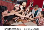 group of happy people eating... | Shutterstock . vector #131122031