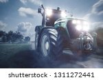 Tractor Driving On A Dirt Road...