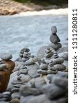 many rock cairns stacked... | Shutterstock . vector #1311280811
