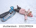 a little girl with a smile and... | Shutterstock . vector #1311299024