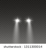 car head lights shining from... | Shutterstock .eps vector #1311300014