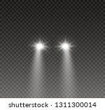 car head lights shining from... | Shutterstock .eps vector #1311300014