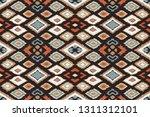 ikat geometric folklore... | Shutterstock .eps vector #1311312101