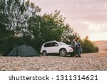 couple standing looking on... | Shutterstock . vector #1311314621