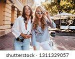 blissful girls posing with... | Shutterstock . vector #1311329057