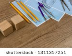 wooden plank with drawing tools ... | Shutterstock . vector #1311357251