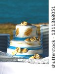 blue and gold wedding cake in... | Shutterstock . vector #1311368051